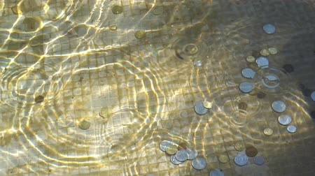 good luck coins : coin in the fountain of happiness Stock Footage