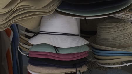 clothing : Hats in outdoor store stacked in a row Stock Footage