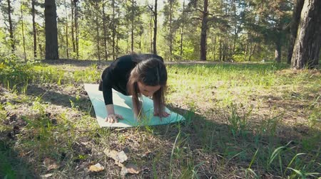 flexibility : young pregnant woman doing yoga outside.
