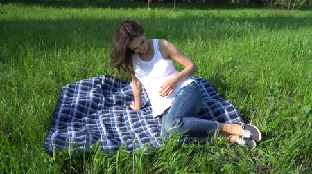 stomach : Happy pregnant woman relaxing and enjoying life in nature.