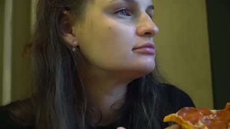 olasz konyha : Cute woman enjoying pizza sitting in cafe. Stock mozgókép