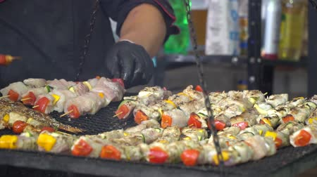 shish kebab : Cooking meat on the charcoal grill. Chicken meat pieces being cooked.