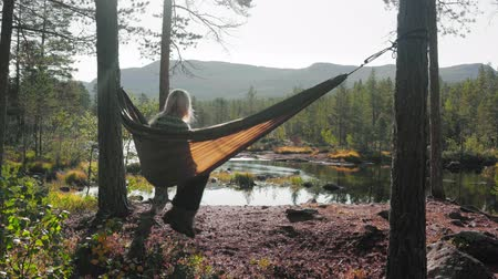 A girl in a hammock in Norway