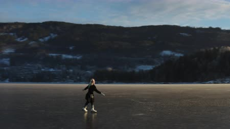 Ice Skating on a frozen lake in Norway Стоковые видеозаписи