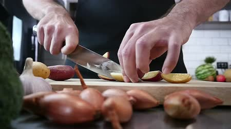 chef cooking : Cook Cutting Potatoes in kitchen Stock Footage