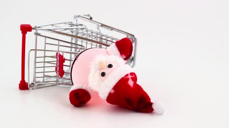 rampant : Santa Claus dropped out from the shopping cart. It is on tilt! A conceptual representation of wrong gift or forgotten. Of rampant consumerism and the loss of the true spirit of Christmas. Stock Footage