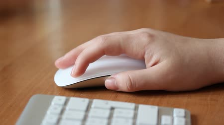 woman hand working with wireless mouse