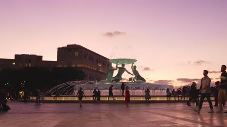 triton : Valletta, Malta, people in Triton square at sunset