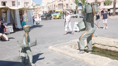 fisherman : Marsaxlokk, Malta, the statue of the fisherman on the dock Stock Footage