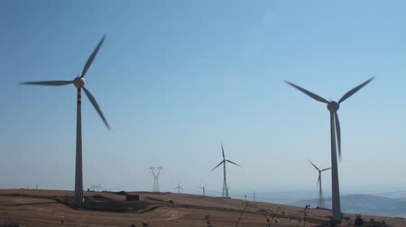energy generation : Field of wind turbines in function on a windy day