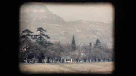 projeksiyon : Vintage 8mm. Original footage digitalized. Mountain and green countryside beside the river Stok Video