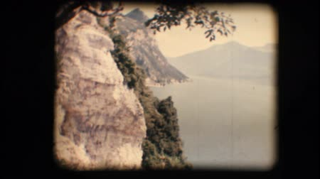 eight : Vintage 8mm. Original footage digitalized. View of mountains and beautiful lake