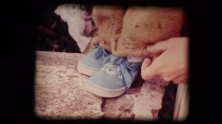 step : Vintage 8mm. Original footage digitalized. Shoes of a little baby trying his first steps Stock Footage