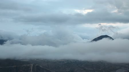 sztratoszféra : Rain cloud timelapse and mountains, over Mitad del mundo, a town built exactly on the Equator, in Ecuador