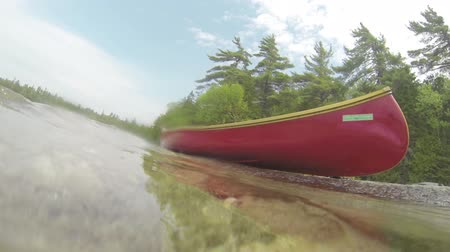 kano : Canoe on the shore of a Canadian lake