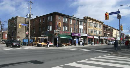 architecture and urbanism : Establishing shot of crossing in Korea town neighbourhood in Toronto, Canada