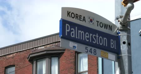 architecture and urbanism : Street sign of Palmerston boulevard in Korea town neighbourhood in Toronto, Canada Stock Footage