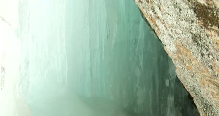 icefall : Cave underneath small icefall in Algonquin Provincial Park, Ontario, Canada