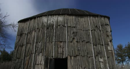 reconstructed : Iroquois longhouse in a reconstructed 15th century native american Iroquoian village in Crawford lake, Ontario, Canada