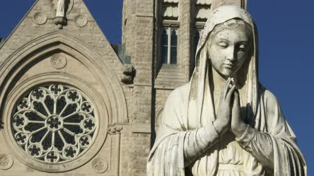 ruhanilik : Statue in front of the Basilica of our Lady Immaculata in Guelph Ontario Canada. The church was built between 1875 and 1883 designated as National Historic Site of Canada in 1990 and designated basilica by Pope Francis in 2014