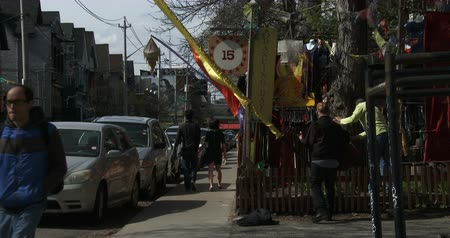 hippie : Tourists walk in a small street in Kensington Market, a multicultural neighborhood in Toronto. It was proclaimed a National Historic Site of Canada in November 2006 Stock Footage