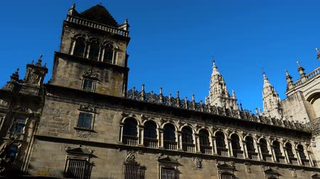 final destination : Lateral side and entrance of the cathedral in Santiago de Compostela, Spain, culmination of the Camino de Santiago pilgrimage route Stock Footage