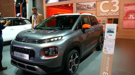 citroen : Journalist beside new Citroen SUV C3 model at the IAA car show in Frankfurt, Germany on September 13, 2017. Stock Footage