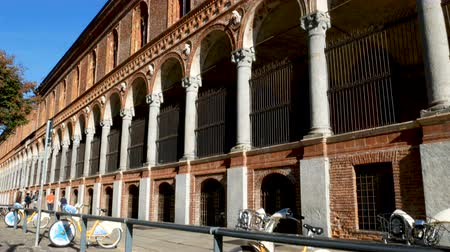 faculty : Bike sharing station in front of the Statale, in public university in Milan, Italy ..