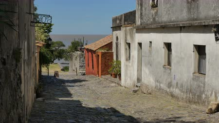 Small pedestrian street in the historic center (at Unesco World Heritage site) of Colonia del Sacramento, Uruguay. Стоковые видеозаписи