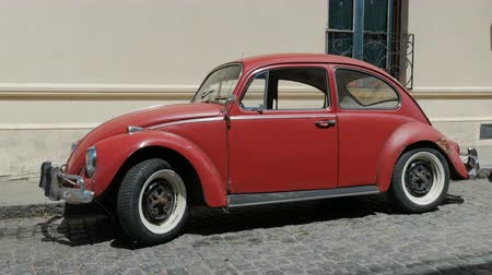 Red Volkswagen Beetle parked in Colonia del Sacramento, Uruguay.
