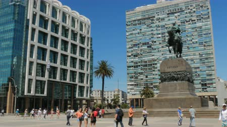 Tourists walk in the Plaza General Artigas in Montevideo, Uruguay, on December 9, 2017.