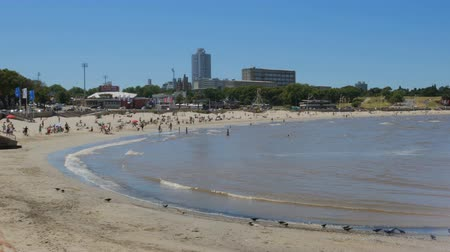 People on playa Ramirez on a sunny day in Montevideo, Uruguay.