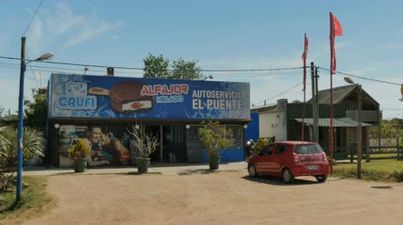 Establishing shot of a grocery store in Barra de Valizas, Uruguay.