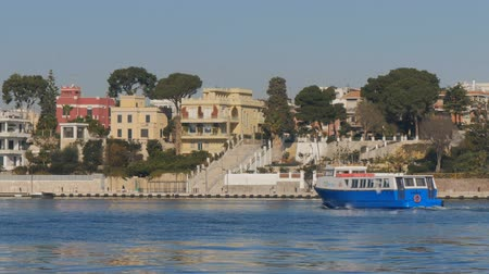 balsa : Small ferry navigates in the port of Brindisi, Italy.
