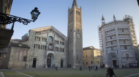 romanesk : Cathedral and Baptistery of Parma in Italy on a Sunny Day in Timelapse Stok Video