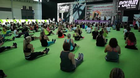 Rimini, Italy - may 2019: Fitness Workout at Gym: Exercises with Music and Green Drum Stick at Rimini Wellness 2019 Стоковые видеозаписи