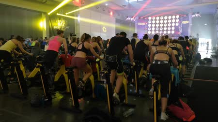 Rimini, Italy - may 2019: Workout with Spinning Bike at Rimini Wellness 2019. Стоковые видеозаписи