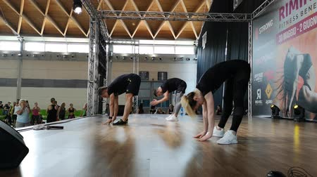 Rimini, Italy - June 2019: Fitness Teachers Give a Demonstration Performance on Stage Стоковые видеозаписи