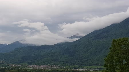 panoramic shot of mountains and clouds