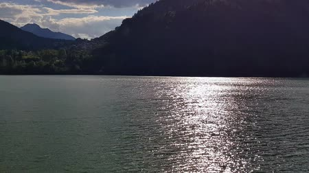 panoramic view of a lake in the alps - lake between the mountains concept Stok Video