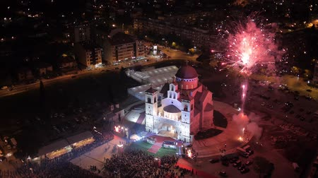 Черногория : Flying over the orthodox church in Montenegro during the night celebration fireworks.
