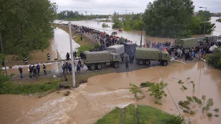 floods : Army and police rescue teams saving people from heavy floods.