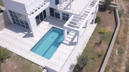 holiday villa : Aerial view of construction of modern villas with swimming pools. Stock Footage