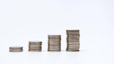 bank tower : Rising columns of coins. Stock Footage