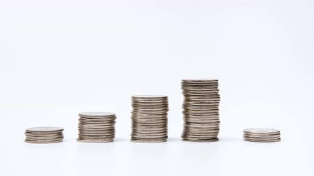 stop motion : Rising columns of coins. Stock Footage