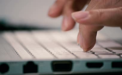 computer programmer : Man hands typing on a computer keyboard.