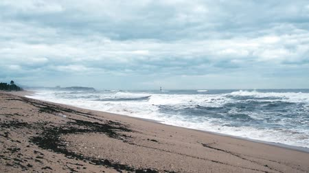 perigoso : A seashore scene in which high waves come with cloudy weather and strong winds. South Korea Donghae the sea. Stock Footage