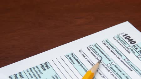 Pen on US TAX form Background. Tax Day concept. Stok Video