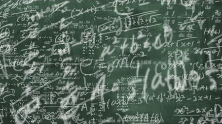 fizik : a blackboard full of mathematical formulas. educational concept background