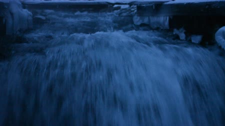 citynight : Waterfall on little winter river Stock Footage